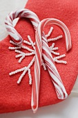 Two candy canes on red felt boot