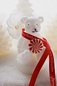 Polar bear candle with peppermint and ribbon
