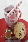 Christmas drink with candy canes and cookies