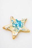 A star biscuit decorated with blue sugar