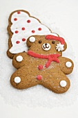 Two Christmas biscuits (teddy bear & Christmas tree) on sugar