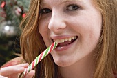 Woman eating candy cane
