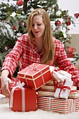Woman delighted with her Christmas gifts