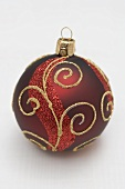 Red Christmas bauble with gold decoration