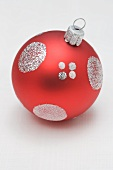 Red Christmas bauble with silver decoration