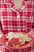 Woman holding plate of gingerbread men