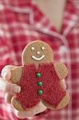 Woman holding gingerbread man