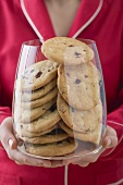 Woman holding glass full of cranberry cookies