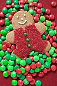 Gingerbread man on red and green chocolate beans