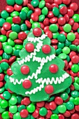 Christmas tree biscuit on red and green chocolate beans