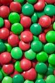 Red and green chocolate beans (full-frame)