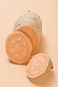 A sweet potato, partly sliced