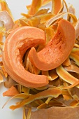 Wedges of pumpkin on pumpkin peelings