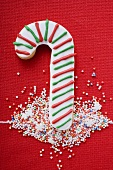 Candy cane biscuit with coloured sprinkles
