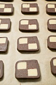 Biscuits cut from chocolate and plain dough in rows