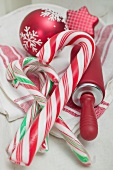 Candy canes, rolling pin and Christmas tree ornament
