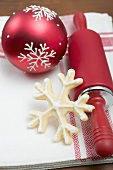 Christmas biscuit, rolling pin and Christmas bauble