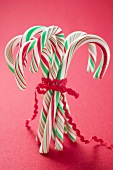 Several candy canes tied together
