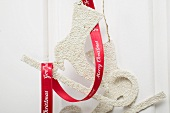 Christmas decoration: skates with red ribbon