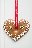 Decorated gingerbread hanging on red ribbon (Christmas)