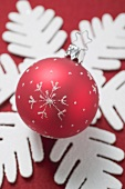 Christmas decoration: Christmas bauble on felt snowflake