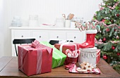 Christmas gifts, candy canes, gingerbread on kitchen table