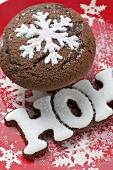 Chocolate muffin and the word HOHO on festive plate