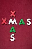 The word XMAS on red background