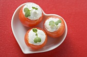 Tomatoes with soft cheese stuffing in heart-shaped dish
