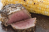 Peppered steak with corn on the cob