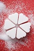 Heart-shaped sugar lumps, arranged in a circle
