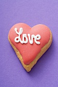 Heart-shaped biscuit with the word Love for Valentine's Day