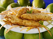 Deep-fried fish in batter on shredded carrot