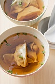 Clear broth with wontons and mushrooms (Asia)