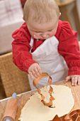 Baby cutting out biscuit