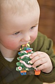Baby eating jelly Christmas tree