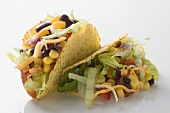 Two tacos filled with sweetcorn and beans