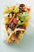 Taco with vegetable filling on paper napkin