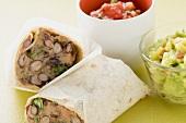 Bean burritos, guacamole and salsa in small bowls