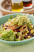 Lettuce, beans, sweetcorn, tortilla strips and guacamole