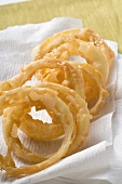 Deep-fried onion rings on kitchen paper