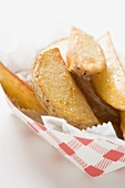 Potato wedges in cardboard container