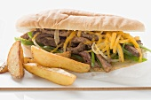 Steak and cheese sandwich with potato wedges