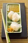 Dim sum with sweet and sour sauce (Asia)