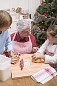Grandmother and two grandchildren baking for Christmas