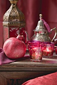 Middle Eastern decorations: pomegranate, windlights, teapot