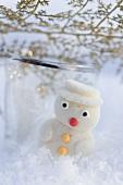 Small marzipan snowman in snow