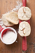 Almond biscuits on and beside rolling pin