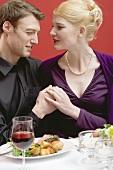 Elegant couple eating in a restaurant