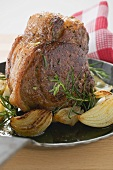 Veal loin steak with onions and rosemary in frying pan